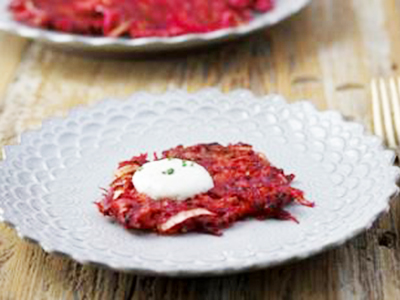 Make an alternative to the usual potato latkes with this Joy of Cooking Hanukkah recipe for colorful beet and carrot latkes