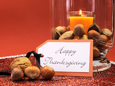 Beautiful Happy Thanksgiving table setting centerpiece with orna