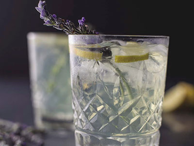A glass of Lavender Tulsi Sparkling Water