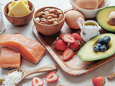 Tray of fish, fruit, eggs, avocado, and nuts